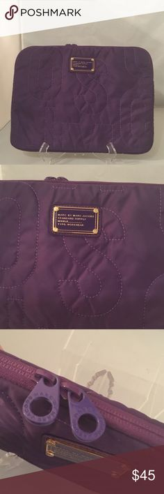 MARC BY MARC JACOBS LAPTOP/TABLET BAG MARC BY MARC JACOBS LAPTOP/TABLET BAG. NEVER BEEN USED. CLEAN INSIDE.IN GREAT CONDITION/PURPLE COLOR/LOGO AT FRONT/ Marc by Marc Jacobs Bags Laptop Bags