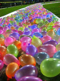 Water balloon slip and slide .. I want to do this soooooo bad!