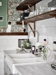 I'm not usually one for a boho-look, with lots of patterns and frills, I tend to move more towards white walls and minimal furniture, but I love the look ofthis lovely boho home. I can just about handle that touch of William Morris 'Pimpernel' wallpaperbecause it contrasts so well with the sleek modern kitchen, with its clean white tiles and stainless steel units. The deep, russet shades are further picked up in the dark wood shelving and mis-matched, mid-century furniture. Who'd have…