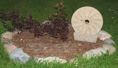 version of an antique millstone made from hypertufa- see how