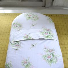 Fitted bassinet sheet tutorial.  Fold over in back rather than elastic.