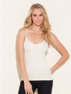 Extreme versatility and comfort make this cami an essential basic. Removable padding and adjustable straps make sure it fits just right. Stock up in every color. ? V-neck. Sleeveless with adjustable spaghetti straps. Formfitting. ? Subtle design at bust. Scalloped trim. Removable bra pads. ? 92% Nylon, 8% Spandex ? Machine wash Women > Tops > Tanks and Camis