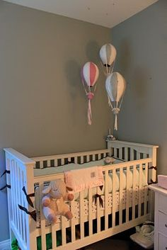 Papier mache hot air baloons over crib.  I am so doing this.
