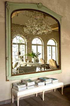 Beautiful French entryway idea large antique mirror and bench seat. French interior design