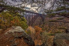 The iconic New River Gorge Bridge as seen from the Bridge Buttress on a rainy autumn afternoon.  WWW  Facebook  G+