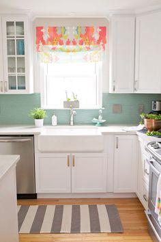 white kitchen with aqua glass tile backsplash