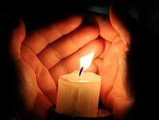 Burning candle in a hand candle hand palm candle № 18115