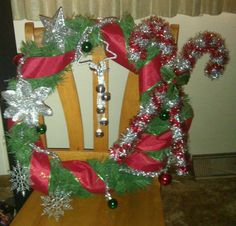 Don't spend $30 on a store bought wreath when for less than $10 you can make one in twenty minutes!!!! $4 plain wreath from walmart and $5 worth of decorations from Dollar Tree...DIY and customize!