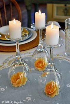 Centerpiece idea | wine glass upside down + candle + something inside