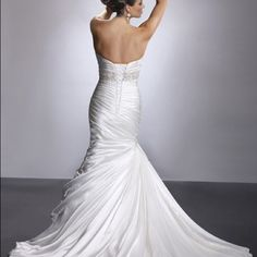 Wedding Gown Adorae-Maggie Sottero. Includes dress, veil and jacket. Dresses