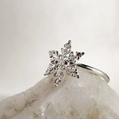 Etsy listing at https://www.etsy.com/listing/171287395/snowflake-ring-sterling-silver-winter