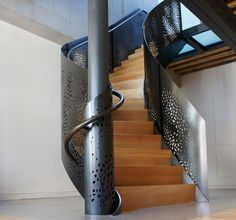 Steel and wood spiral staircase, LOVE these stairs, and the fiancé loves steel work so it's perfect!