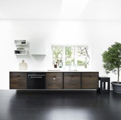 SkabRum kitchen made of smoked oak with white corian worktop. Five individuel cabinets. #kitchen #oak #smokedoak #wood #cabinets #danishdesign #madeindenmark #furniture #carpentry #joinery
