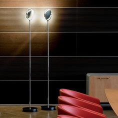 The Nobi floor lamp from Fontana Arte features an adjustable head.  This floor version is paired with the optional metal reflector which allows you to direct the light, 360 degrees.    www.illuminc.com