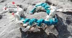 Nice bracelet  made with gold chain and twisted white and turquoise suede