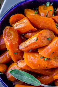 Simple carrots slow-cooked with butter and herbs make for an easy summer side dish.
