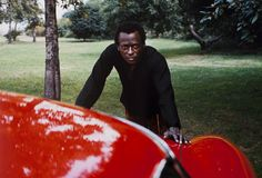 Miles Davis, Red Ferrari, New York City, 1969 – Image by © Baron Wolman  https://theselvedgeyard.wordpress.com/2012/08/05/miles-davis-its-not-about-standing-still-and-becoming-safe/