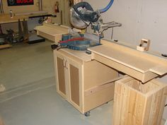 Miter Saw Station. Good use of t-track for stop blocks.