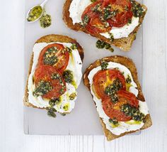 Tartines with roasted tomatoes & mint pesto. French open-faced cheese and tomato toasted sandwiches, drizzled with light mint and garlic pesto and spread with ricotta