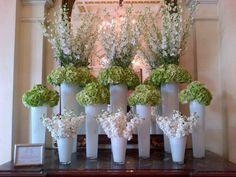 Green and white hotel lobby display. White delphinium, green hydrangea and white stock.