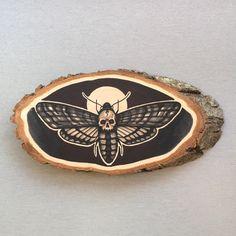 Wood slice with an original drawing of a deaths door Inkspirednl