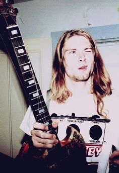 Kurt Cobain- he reminds me of my brother so much- talented, handsome devils gone before their time ...but still rocking in our hearts