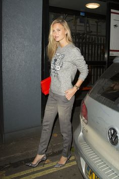 Bar Refaeli made going out to dinner an occasion for cool fashion improvisation with a Kenzo sweatshirt and gray trousers.