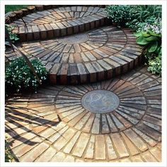 circular patterns brick | GAP Photos - Garden & Plant Picture Library - Semi-circular brick ...