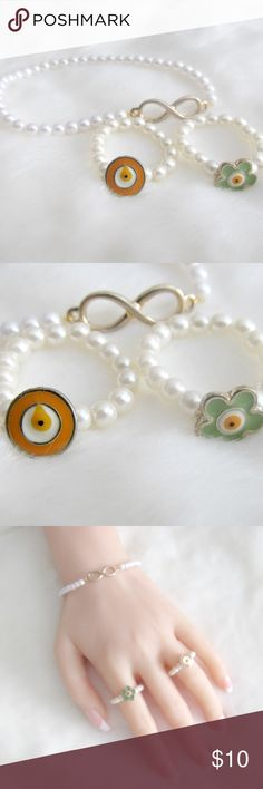 Faux Pearl Evil Eye Infinity Ring Bracelet Bundle A 3 Piece Evil Eye faux pearl set.  The rings have evil eye focal point and the bracelet has an infinity charm. The infinity charm appears somewhat...faded? The Mal De Ojo charm, aka Evil Eye, is historically said to ward off bad luck. This charm can be found in many cultures.  Condition: NWT Style: Jewelry Type: Bracelets Brand: Citizen Republk Color: Ivory, Green Orange Materials: Faux Pearls, Enamel, Metal alloy…