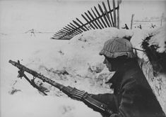 German soldiers with machine gun MG-34 in a trench near Leningrad.
