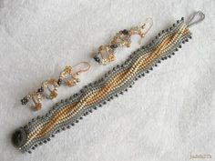 The bracelet was designed by Rae Arlene Reller, published in Bead & Button Magazine, February 2009, Issue 89, pp.48-49. The earrings were designed by Gwen Fisher, and can be found at http://gwenbeads.blogspot.com/2011/04/how-to-bead-weave-dna-double-helix.html#
