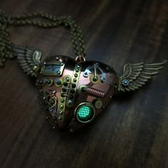 Four Chambers    Reserved - Please dont buy.    Here is one of my signature steampunk pieces - the mechanical flying heart. Although I make many