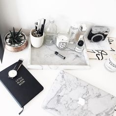 Loving the laptop cover, succulent, and marble tray. Paris, Prada, Pearls, Perfume