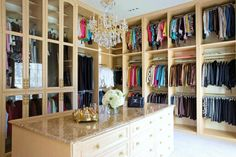 walk in closet idea. Loving all of the space and putting rarely used items behind glass doors. Also, the island would be perfect spot for bags, purses, or jewelry! I'd like an L-shaped one though with a lounge chair in between. good for separating hubby's stuff from mine : )