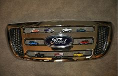 Displaying Hot Wheels trucks in a Ford truck grille