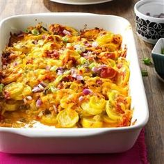 Tex-Mex Summer Squash Casserole Recipe -Mild-flavored yellow squash gets a big boost from flavor-packed chilies, jalapenos and red onion. This side dish also works with zucchini. —Tommy Lombardo, Euclid, Ohio