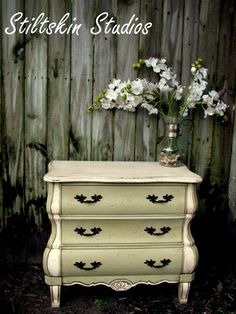 Versailles and old white chalk paint dresser. GORGEOUS!!  Look at those curves-furniture should be like a woman-curvy and feminine, not boxy and stumpy