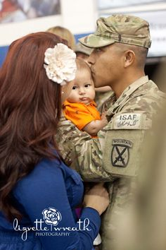 Soldier meets his baby for the first time