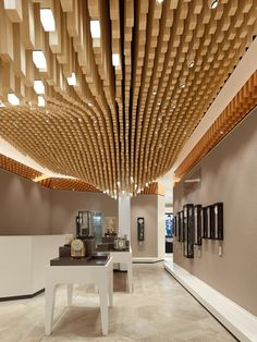 Ippolito Fleitz Group carves out an undulating wooden canopy for a watch store…
