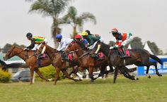 "NAIROBI (Xinhua) -- The opening of the horse racing season in Kenya was held at the Ngong Race course on Sunday. Winner of Britam Kenya Guineas Race Bawan Sooful, a jockey from Mauritius leads the 3200 meters horse race at Ngong Race Course in Nairobi. Riding a horse dubbed ""Spring Run"" which is owned by Margaret Shava, Bawan Sooful managed to defeat 14 other horses. XINHUA PHOTO -SIMBI KUSIMBA"