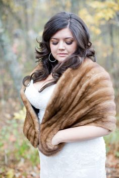 We love the idea of a fur stole teamed with your wedding dress - a perfect autumn cover-up!