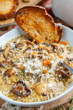 Creamy Mushroom Chicken and Wild Rice Soup A warm and creamy mushroom, chicken and wild rice soup that is down right one of the best comfort food around! - Creamy Mushroom Chicken and Wild Rice Soup Creamy Mushroom Chicken, Chicken And Wild Rice, Creamy Mushrooms, Creamy Chicken Rice Soup, Creamy Turkey Soup, Chicken Broth Soup, Chicken Mushrooms, Yogurt Chicken, Orzo Soup