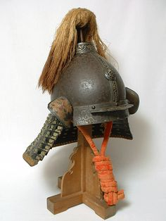 """Yuan Mongol Kabuto, Yuan Period Late 1300's to early 1400's, the only example of its type that we have ever seen other than the few known examples in museums. This beautiful piece was most likely taken as a """"war trophy"""" on the battlefield during one of the Mongol Invasions of Japan. This piece was remounted with a shikoro to be worn by a Samurai of a high ranking, possibly a Daimyo. The state of preservation is unlike anything some members of the Japanese Armor society had ever seen."""