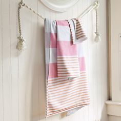 Love the idea of hanging the towel on a rope.  Never would have thought of that.