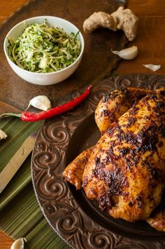 Ginger and chili roast chicken with sticky carrots and zucchini salad