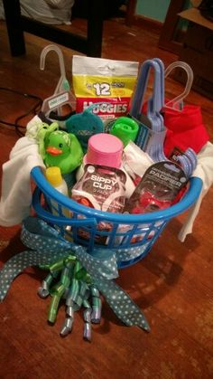 Boy baby shower gift basket: Dreft baby laundry detergent, baby hangers, washcloths, baby shampoo, a rubber duck, nursery air freshener, huggies sample pack, wipes, pacifiers, pacifier wipes, pacifier clip, sippy cups, 2 outfits. Easy $30-40 gift! #babyshower #babyboy #diy #giftbasket #giftideas #baby