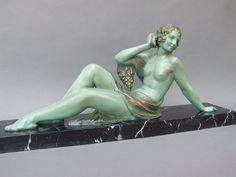 "This large green patinated spelter is Echo (1) by Demetre CHIPARUS, Signed to the right hand end of the base - D H Chiparus. She measures 13.5"" H. (34cm). Base is of black and white striated marble. The same statue can be viewed in the Chiparus book on p. 64. (hva)"
