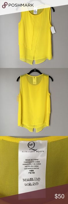 McQ by Alexander McQueen Yellow Layered Blouse What's up, buttercup? Show your sunny disposition in this McQ by Alexander McQueen bright yellow top with delicate layered fabric at front and round neckline. New with tags, but extremely faint marks at neckline and lower front panel (see photos). No size listed, but I'd say this is medium-happy to take measurements! McQ by Alexander McQueen Tops Blouses