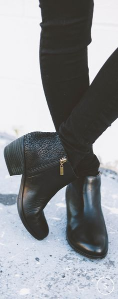 A textured leather heel adds interest to these classic black zip ankle booties by Clarks. Shop now on SHOES.COM.