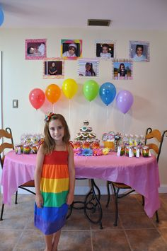 Rainbow Birthday Party. Love the balloons and pics of little girl.